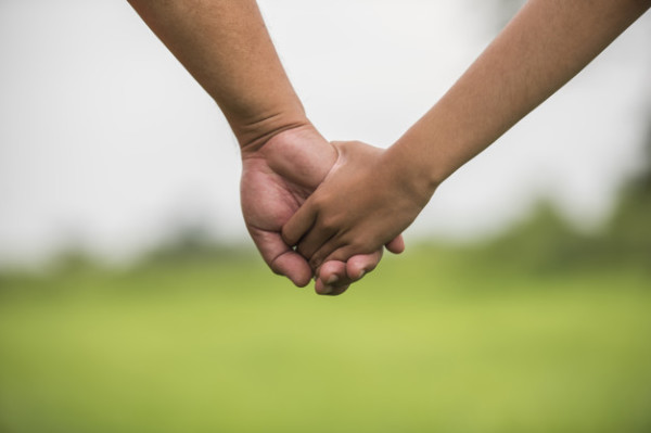 Father and daughter holding hand in hand together